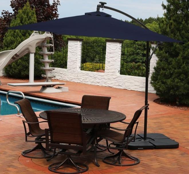 Sunnydaze Solar LED 10-Foot Offset Patio Umbrella with Cantilever, Crank, and Cross Base -Navy blue